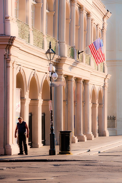 lonely figure standing questioningly in the bright sun of a French Quarter morning outside the Cabildo on Jackson Square in New Orleans