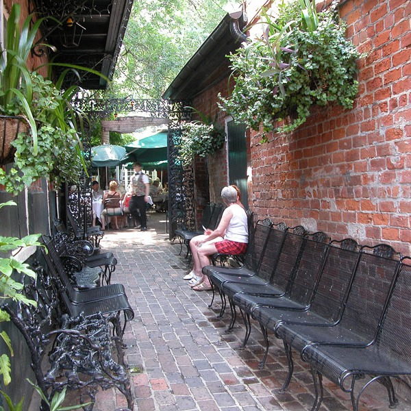 French Quarter garden passage leads to larger dining court