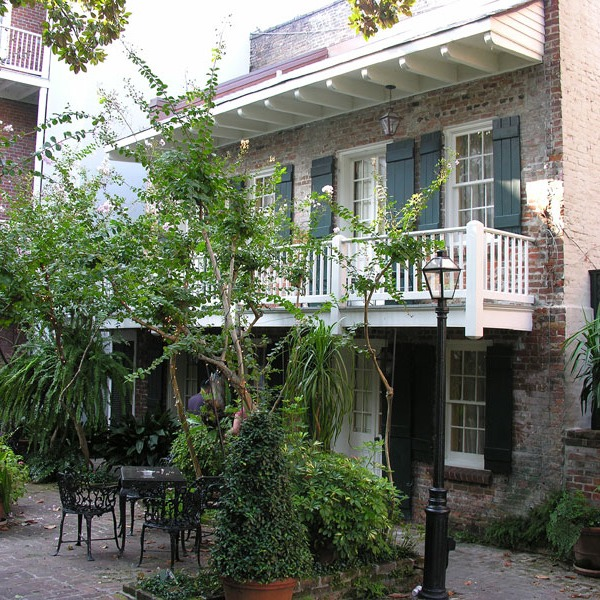 main house & guest cottage flank French Quarter garden room