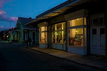 double bay storefront in New Orleans French Quarter at dusk