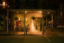New Orleans French Quarter gallery and shopfront at night
