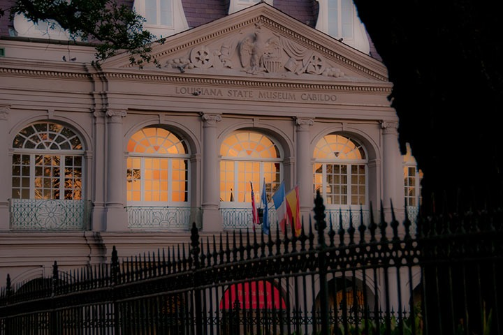 The Cabildo Museum sits solitary against the first rays of sunrise at the corner of Jackson Square in New Orleans' French Quarter
