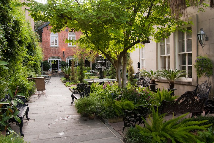 French Quarter courtyard garden rooms serve as anterooms by day and dining rooms by night for New Orleans restaurant