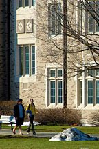 two students walking across quad at University of Notre Dame in South Bend, Indiana