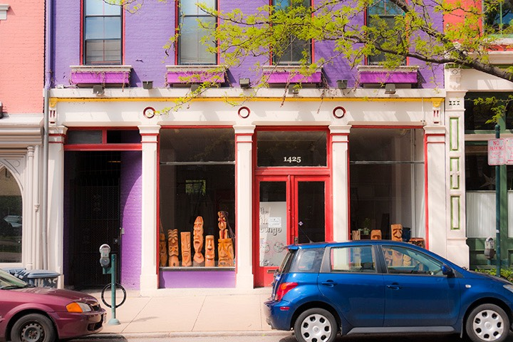 brightly-colored red, lavender, and white storefront along recovering street in Cincinnati's Over-The-Rhine neighborhood