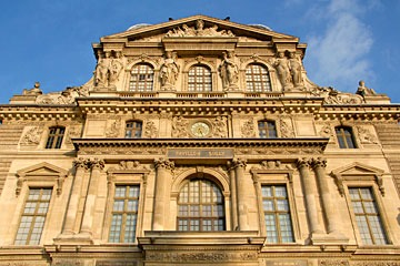 Paris Louvre upper level and gable with elaborate stone ornament