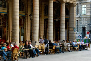 street cafe along colonnade of Palais Royale in Paris