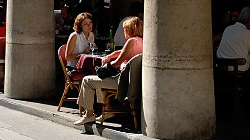two women having lunch at sidewalk cafe at Rue des Colonnes in Paris