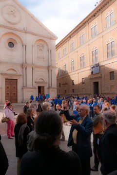 crowds of people in Piazza Pio II in Pienza, Italy