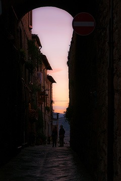 sunset through the Western gate of Pienza, Italy