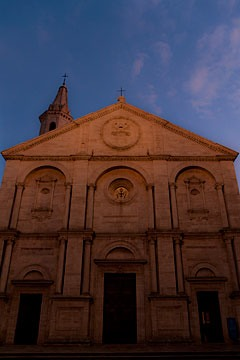 Pienza, Italy cathedral front in fading evening light