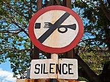 "traffic sign with slash across silhouette of a horn, and with the word ""Silence"" in Port Louis, Mauritius"