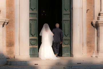 father and bride entering church in Rome, Italy