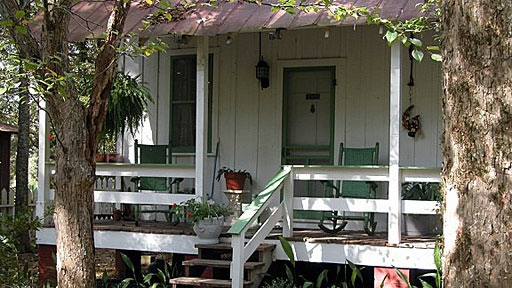 front porch of one of the outbuildings at the Rosemont plantation in southern Mississippi