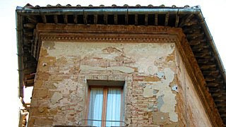 eave of building in Pienza, Italy