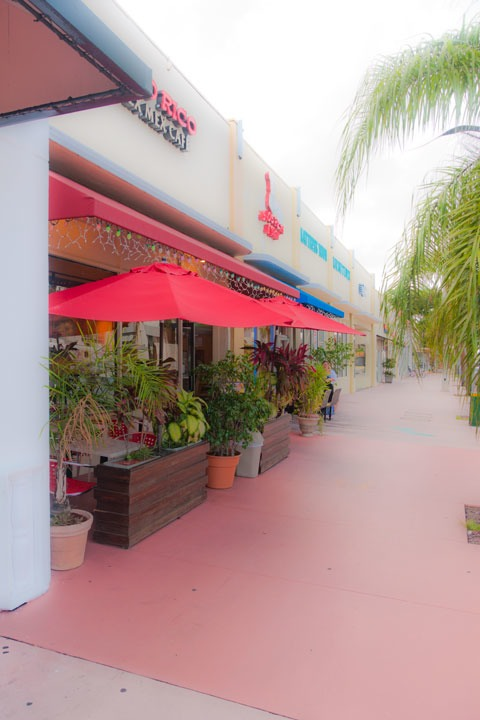 sidewalk cafe on Alton Road, South Beach tucked into recess along shop fronts