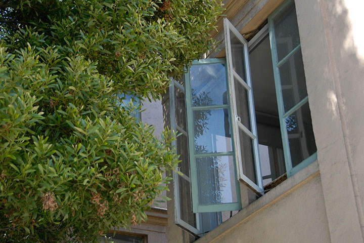 aqua casement windows open to San Francisco summer breezes
