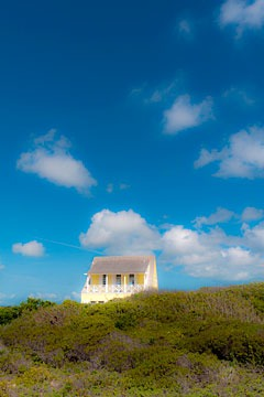 house looking across preserved coastal vegetation at Schooner Bay, Bahamas