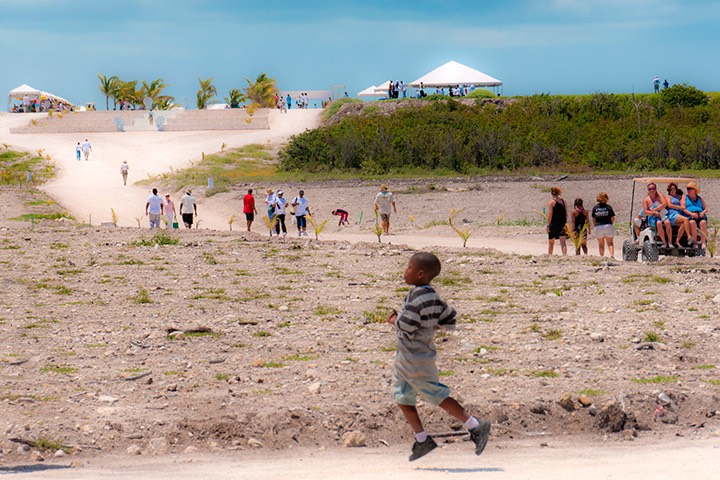 young Bahamian boy caught aloft in mid-stride at Schooner Bay