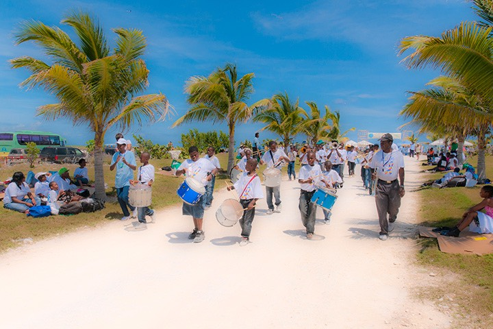 local school band marching through the streets of Schooner Bay on a sunny spring day on south Abaco, Bahamas
