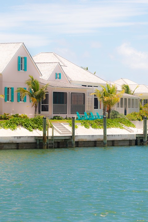 Schooner Bay cottages overlooking the seawall on the harbour island