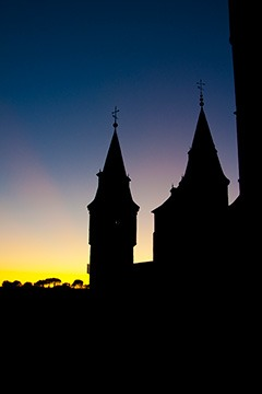 last fading rays of sunset silhouetting the castle of Segovia, Spain