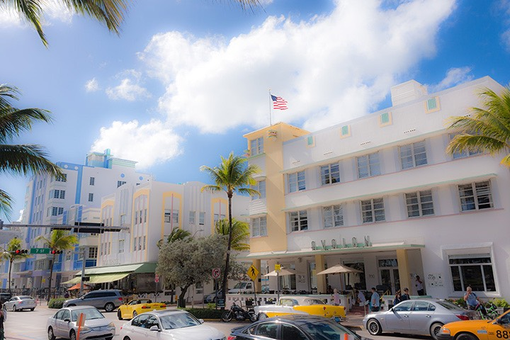 Ocean Drive Art Deco hotels bathed in sunny sea breezes along Lummus Park on world-famous South Beach