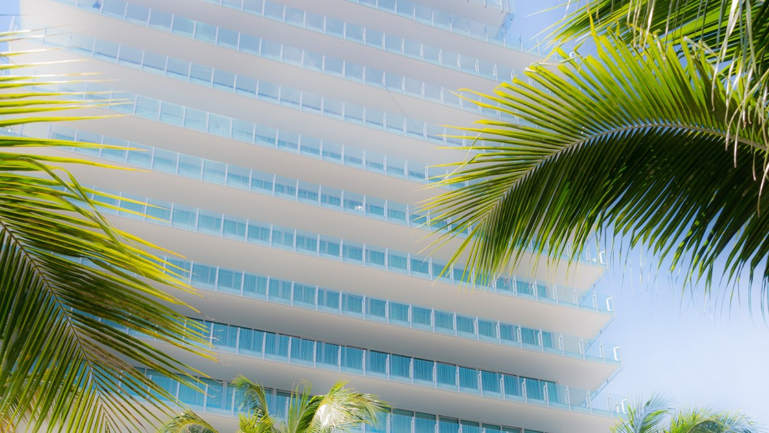 CorbMiesian Revival architecture rises amid the palm trees south of 5th street on South Beach.