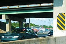 traffic rushing under interstate bridges in Montgomery, Alabama