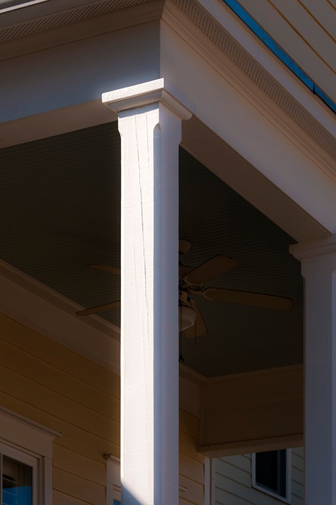 simple timber column shows it is solid with the cracks along its side