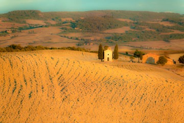 farm compound and chapel near sunset in Tuscany's Val D'Orcia